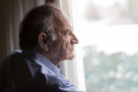 Close up of a senior man contemplating