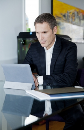 Businessman working at home on a tablet