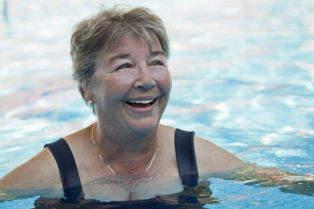only senior women: Senior woman swimming at the pool
