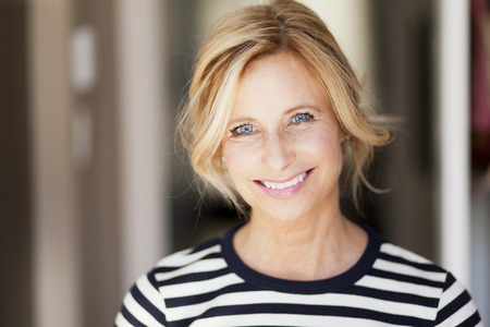 Mature woman smiling Standard-Bild