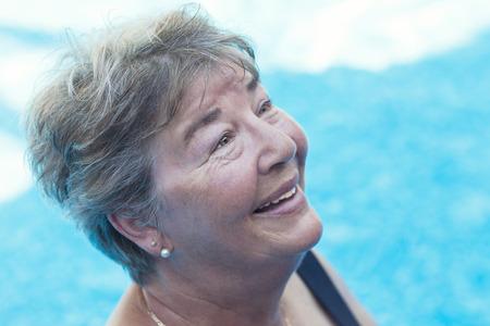 65 69 years: Senior Woman Swimming in a Pool Stock Photo