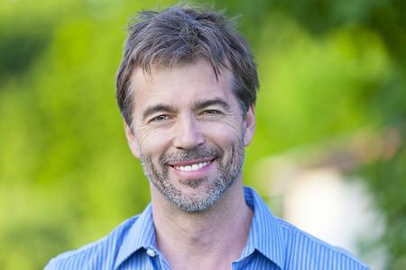 Portrait Of A Mature Man Smiling photo