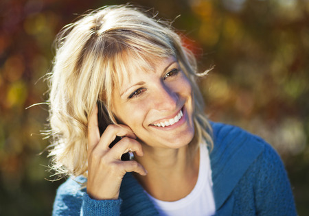 Mature Woman Talking On The Phone photo