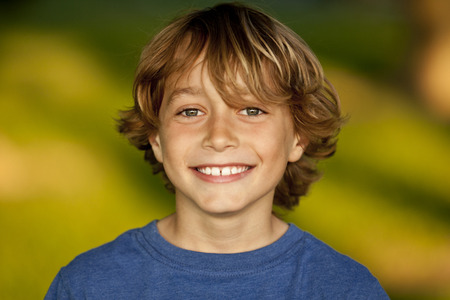 boy long hair: Portrait Of A Happy Young Boy