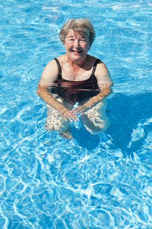 65 69 years: Senior Woman Swimming At The Pool