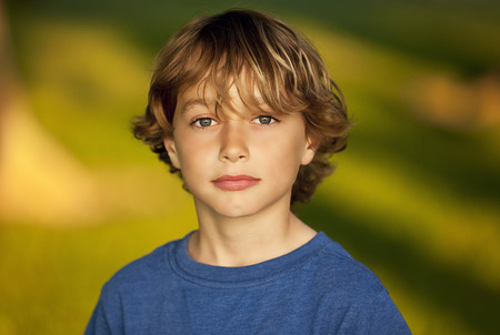 blond boy: Serious child