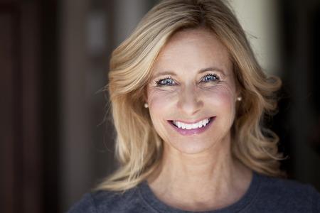 woman close up: Mature woman smiling at the camera