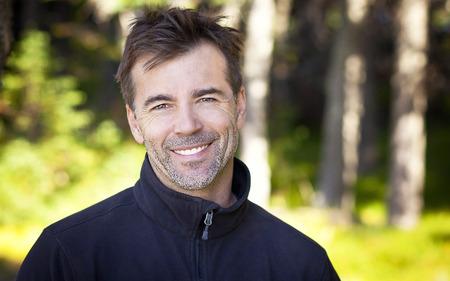closeup portrait: Portrait Of A Mature Man Smiling At The Camera