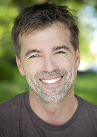 attractive male: Portrait Of A Mature Confident Man Smiling At The Camera