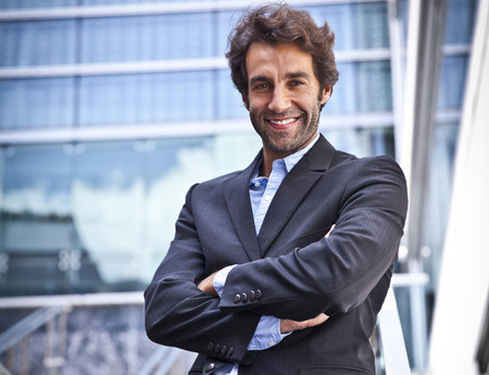 Proud Businessman smiling in front of his office Banco de Imagens