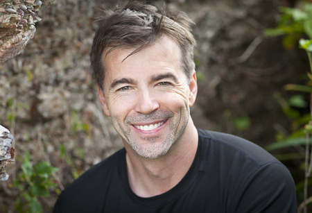 Portrait Of A Mature Active Man Smiling At The Camera photo