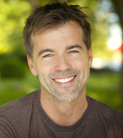 smile teeth: Portrait Of A Mature Confident Man Smiling At The Camera