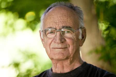 one senior man only: Portrait of Elderly man looking At the Camera Stock Photo