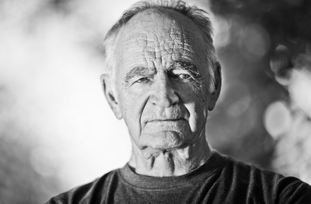one man only: Elderly man lost in Thought Stock Photo