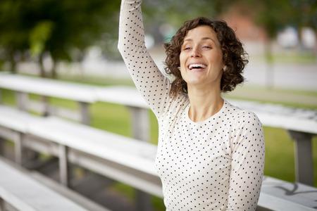 cheering: Woman Cheering At The Park Stock Photo