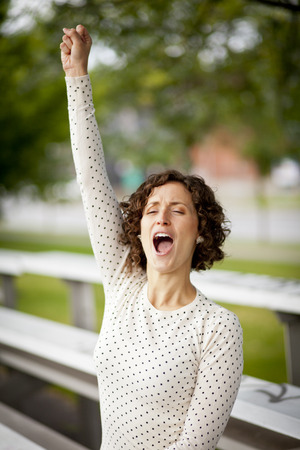 sport celebration: Woman Cheering At The Park Stock Photo