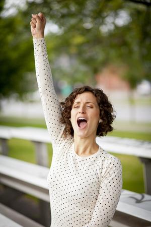 Woman Cheering At The Park 版權商用圖片