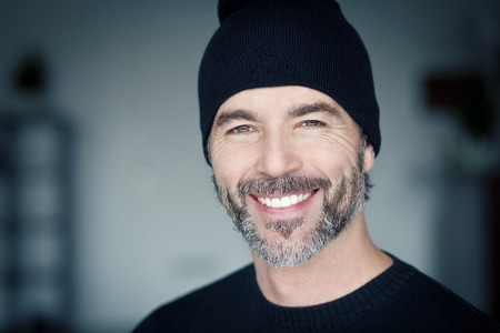 toque: Close Up Of A Mature Man Wearing A Toque Smiling At The Camera Stock Photo