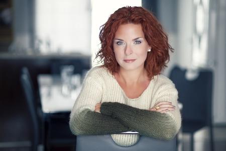 Mature red woman smiling at the camera Banco de Imagens