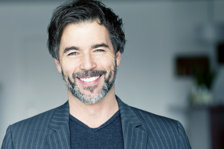 Close Up Of A Mature Man Smiling At The Camera