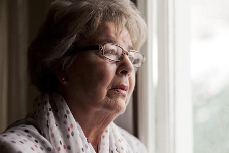 one senior woman only: Depression Of A Senior Woman Stock Photo