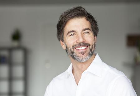 Successful Mature Man Smiling Looking Away Stockfoto