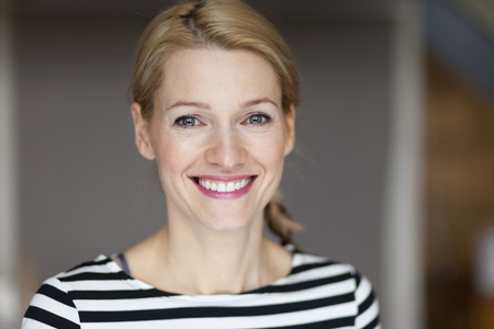 Close up Of A Smiling Italian blond woman