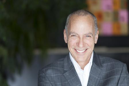 Mature Businessman Smiling At The Camera