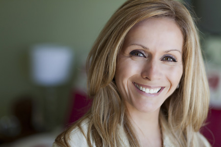 Mature blond woman smiling at the camera