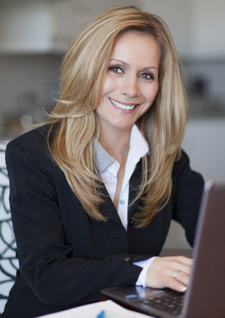 Mature Businesswoman Working At Home Standard-Bild