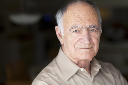 one senior man only: Portrait of Elderly Man Smiling At The Camera Stock Photo