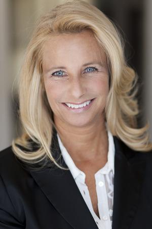 closeup portrait: Mature woman smiling at the camera