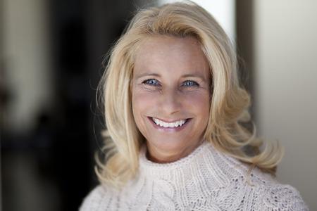 Blonde Mature woman smiling