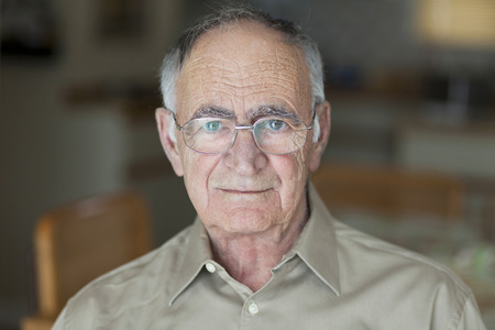 60 64 years: Portrait Of A Senior Man Smiling At The Camera Stock Photo