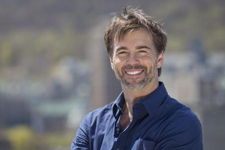 Portrait Of A Mature Active Man Smiling At The Camera 免版税图像