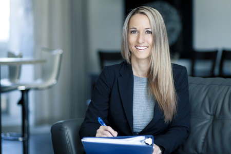 insurance agent: Blond Confident Businesswoman Working At Home Stock Photo