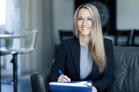 Blond Confident Businesswoman Working At Home Standard-Bild