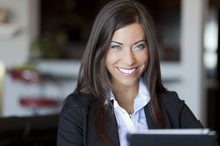 home business: Confident Businesswoman Working At Home