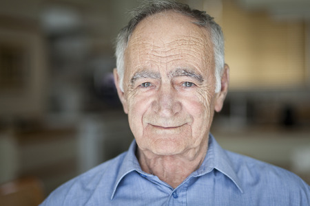 80 plus adult: Portrait Of A Senior Man Smiling At The Camera Stock Photo