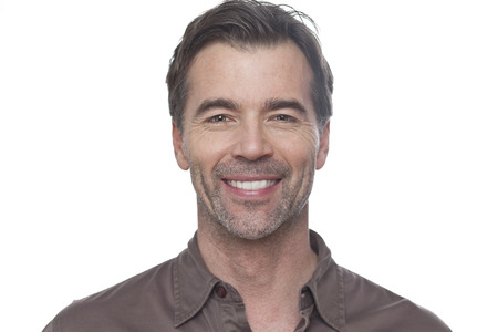 male face: Portrait Of A Mature Man Smiling At The Camera Isolated On White Stock Photo
