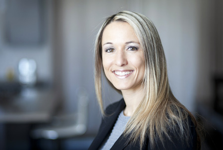 Blond Confident Businesswoman Working At Home Stockfoto