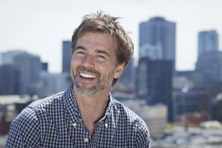 Portrait Of A Mature Active Man Smiling In a city Stock Photo