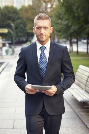 mature businessman: Mature Businessman Smiling At The Camera. He is outside of the office
