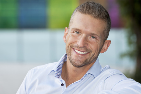 trust people: Closeup Of A Mature Man Smiling At The Camera. He is outside of the office Stock Photo