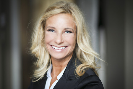 mature women: Portrait Of A Mature Businesswoman Smiling At The Camera