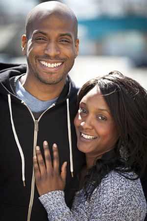 black couple: Portrait Of A Black Couple Smiling At The Camera At The Park