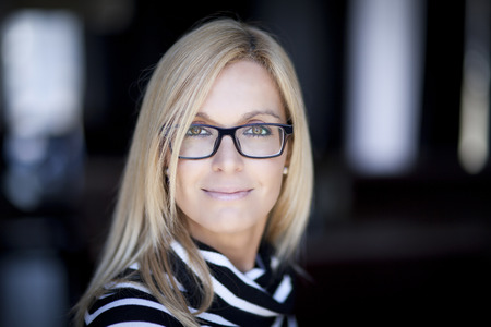 Blond Confident Woman Working At Home. With Glasses. Imagens
