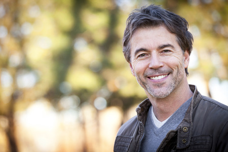 looking to camera: Handsome Mature Happy Man Smiling At The Camera.Outside. Stock Photo