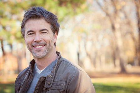 Portrait Of A Mature Man Smiling At The Park