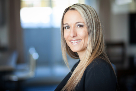 Portrait Of A Businesswoman Smiling At The Camera Stock Photo